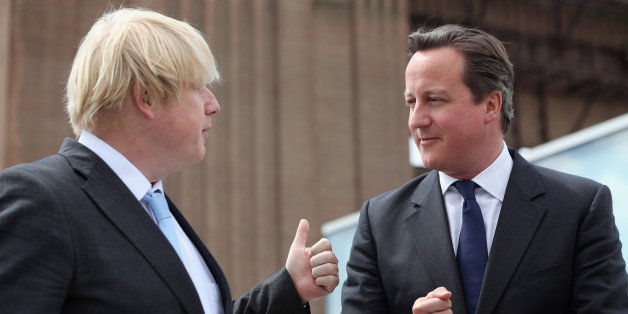 "Prime Minister David Cameron chats to Boris Johnson (left), the Mayor of London, at Battersea Power Station in London. Cameron said it was ""about time"" as he hailed the start of an £8 billion redevelopment of Battersea Power Station."