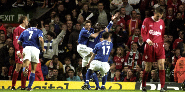 Kevin Campbell celebrates his winner in front of the Kop in 1999