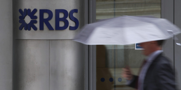 A pedestrian passes a sign outside the headquarters of the Royal Bank of Scotland Group Plc (RBS) in London, U.K., on Wednesday, July 18, 2012. The U.K. financial regulator said it's investigating seven lenders over attempts to manipulate interbank offered rates as lawmakers criticized it for not opening the probe earlier. Photographer: Chris Ratcliffe/Bloomberg via Getty Images