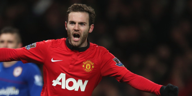 MANCHESTER, ENGLAND - JANUARY 28:  Juan Mata of Manchester United celebrates Robin van Persie scoring their first goal during the Barclays Premier League match between Manchester United and Cardiff City at Old Trafford on January 28, 2014 in Manchester, England.  (Photo by John Peters/Man Utd via Getty Images)