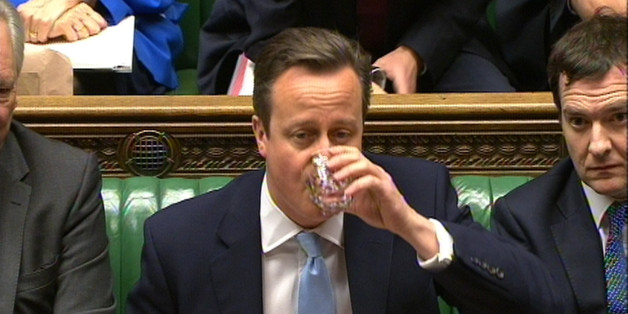 Prime Minister David Cameron takes a sip of water during Prime Minister's Questions in the House of Commons, London.