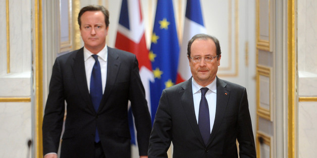 PARIS, FRANCE - MAY 22:  British Prime Minister David Cameron and French President Francois Hollande during a press conference at Elysee Palace on May 22, 2013 in Paris, France. The Prime Minister condemned the killing of a man in Woolwich, south London, earlier today, in what police are treating as an act of terrorism. (Photo by Antoine Antoniol/Getty Images)