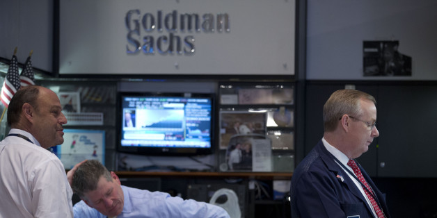 Traders work at the Goldman Sachs Group Inc. booth on the floor of the New York Stock Exchange (NYSE) in New York, U.S., on Friday, Jan. 24, 2014. U.S. stocks fell, pushing the Dow Jones Industrial Average to the biggest weekly decline since June 2012, as equities slumped worldwide amid a selloff in emerging-market currencies. Photographer: Jin Lee/Bloomberg via Getty Images