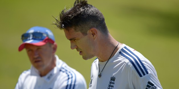 England Ashes Test cricketer Kevin Pietersen (R) speaks with coach Andy Flower (L) during a training session at a suburban cricket ground near Perth on October 29, 2013. Australia will be fighting to win back the Ashes for the first time in six years but injuries, selection woes and a questionable build-up give every sign of a team in upheaval ahead of the first Test against England at the Gabba in Brisbane starting November 21.   AFP PHOTO / Greg WOODIMAGE STRICTLY RESTRICTED TO EDITORIAL USE -