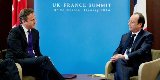 Prime Minister David Cameron (left) attends a meeting with French President Francois Hollande (right) during a one day summit at RAF Brize Norton.