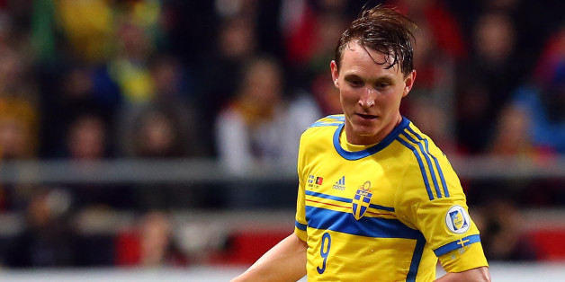STOCKHOLM, SWEDEN - NOVEMBER 19:  Kim Kaellstroem of Sweden runs with the ball during the FIFA 2014 World Cup Qualifier Play-off Second Leg match between Sweden and Portugal at Friends Arena on November 19, 2013 in Stockholm, Sweden.  (Photo by Martin Rose/Getty Images,)