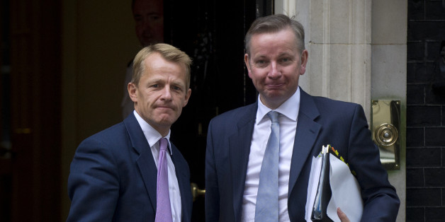 Britain's Conservative Education Secretary Michael Gove (R) and Liberal Democrat minister of state in the Department of Education David Laws (L) arrive at Downing Street in central London on September 5, 2012, for the first cabinet meeting since a government reshuffle. Cameron hopes to inject fresh life into his struggling coalition government with a government reshuffle, while keeping his unpopular finance minister George Osborne.  AFP PHOTO / CARL COURT        (Photo credit should read CARL COURT/AFP/GettyImages)