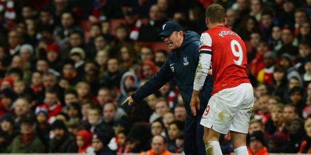Podolski argues with Pulis