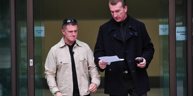 Stephen Yaxley-Lennon (L), also known as Tommy Robinson, the co-founder, spokesman and leader of the English Defence League (EDL) and EDL Deputy Leader Kevin Carroll (R) leave after attending Westminster Magistrates Court in central London, on September 11, 2013. Both are accused of obstructing police by trying to defy a ban on marching to the scene of Fusilier Lee Rigby's murder via the East London Mosque on June 29