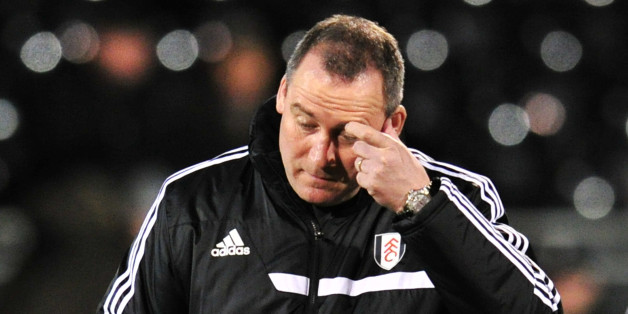 Fulham's Dutch head coach Rene Meulensteen (L) arrives for the English FA Cup fourth round replay football match between Fulham and Sheffield United at Craven Cottage in London on February 4, 2014.  AFP PHOTO / GLYN KIRKRESTRICTED TO EDITORIAL USE. No use with unauthorized audio, video, data, fixture lists, club/league logos or live services. Online in-match use limited to 45 images, no video emulation. No use in betting, games or single club/league/player publications        (Photo credit shoul