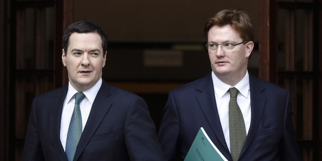 George Osborne, U.K. chancellor of the exchequer, left, and Danny Alexander, U.K. chief secretary to the treasury, leave the HM Treasury building for the Houses of Parliament in London, U.K., on Thursday, Dec. 5, 2013. Osborne will deliver his end-of-year report today against the brightest economic backdrop since the coalition took office more than three years ago. Photographer: Simon Dawson/Bloomberg via Getty Images