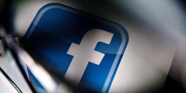 Bloomberg's Best Photos 2013: A Facebook Inc. logo is displayed for a photograph in Tiskilwa, Illinois, U.S., on Tuesday, Jan. 29, 2013. Facebook Inc. is scheduled to report quarterly earnings on Jan. 30. Photographer: Daniel Acker/Bloomberg via Getty Images