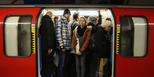 LONDON, ENGLAND - FEBRUARY 05:  Commuters crowd on to a tube at Oxford Street station on February 5, 2014, in London, England. Today marks the first full day of a 48 hour strike by London underground workers. Workers on London's Underground train system began strike action at 9:00 pm on Tuesday February 4, causing chaos for commuters arriving for work this morning.  (Photo by Dan Kitwood/Getty Images)