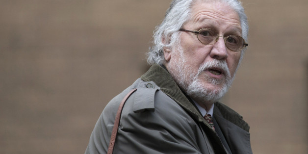 LONDON, ENGLAND - FEBRUARY 05:  Radio presenter Dave Lee Travis arrives at Southwark Crown Court on February 5, 2014 in London, England. Dave Lee Travis, whose real name is David Patrick Griffin, is charged with 14 counts of indecent assaults and one of sexual assault, which allegedly took place between 1977 and 2007 against victims aged between 15 and 29. Dave Lee Travis entered a not guilty plea to the charges in October last year.  (Photo by Oli Scarff/Getty Images)