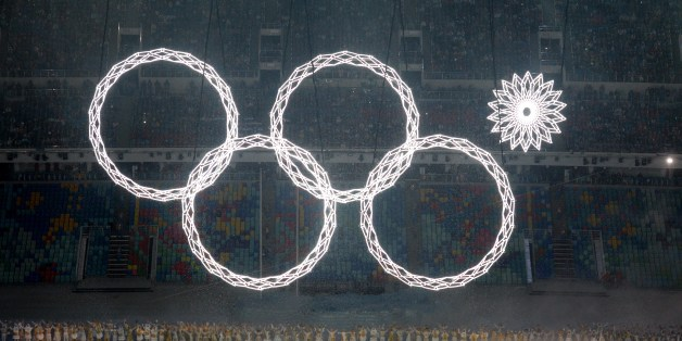 Performers sing as the Olympic rings are presented during the Opening Ceremony of the Sochi Winter Olympics at the Fisht Olympic Stadium on February 7, 2014 in Sochi. AFP PHOTO / YURI KADOBNOV        (Photo credit should read YURI KADOBNOV/AFP/Getty Images)