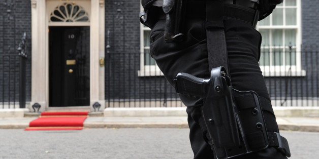 An armed Police officer outside10 Downing Street, London.