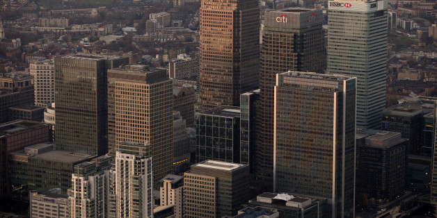 No. 1 Canada Square stands surrounded by the offices of global financial institutions, including HSBC Holdings Plc, Citigroup Inc., and JPMorgan Chase & Co., in this aerial photograph looking north towards Tower Hamlets from Canary Wharf business and shopping district in London, U.K., on Monday, Dec. 9, 2013. Bank of England Governor Mark Carney said Britain's recovery will need to be sustained for a while before it is strong enough to withstand higher interest rates. Photographer: Matthew Lloyd
