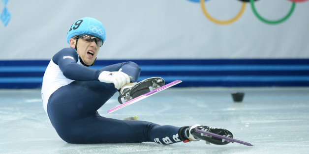 Great Britain's Jack Whelbourne falls as he competes in the Men's Short Track 1500 m Final at the Iceberg Skating Palace during the Sochi Winter Olympics on February 10, 2014.        AFP PHOTO / JUNG YEON-JE        (Photo credit should read JUNG YEON-JE/AFP/Getty Images)