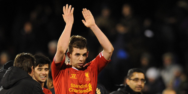 Flanagan applauds the away supporters following Liverpool's win at Fulham