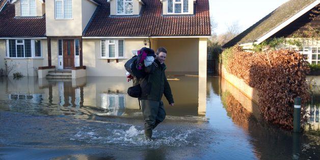 Residents walk through flooding in Wraysbury, Berkshire.