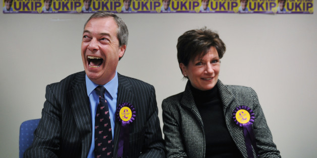 UKIP leader Nigel Farage congratulates their candidate Diane James on coming second in the Eastleigh by-election after holding a news conference in the Hampshire town this morning.