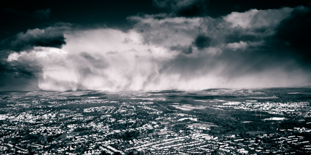 Airborne image of a very heavy snowstorm drifting gently through the Hampshire countryside in December.