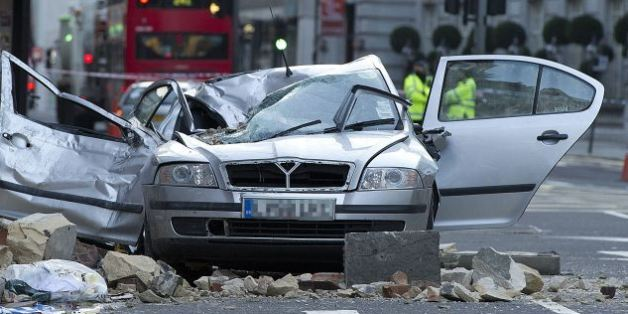Car wrecked after masonry from a building collapsed