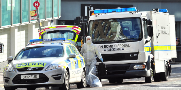 A Royal Navy bomb disposal unit works at the scene where a suspect package was delivered at an Army recruitment office in Brighton, southern England on February 13, 2014. British counter-terrorism police said Thursday they were dealing with a series of suspect packages sent to a string of armed forces recruitment offices. Bomb disposal units have been called to deal with the packages, sent to at least six offices in southeast England, with police sources saying there was a 'low-level' but 'viable' threat. Packages have been sent to offices in Aldershot, Chatham, Brighton, Oxford, Reading, Slough. AFP PHOTO / GLYN KIRK        (Photo credit should read GLYN KIRK/AFP/Getty Images)