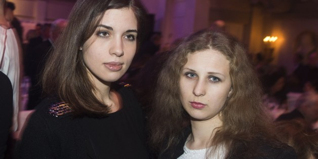 Nadezhda Tolokonnikova (L) and Maria Alyokhina (R) of Russian punk protest group Pussy Riot arrive for the Cinema for Peace gala in Berlin, on February 10, 2014. Cinema for Peace is a worldwide initiative, promoting humanity through film and takes place amongst others on the sidelines of the Berlinale International Film Festival. AFP PHOTO / JOHANNES EISELE        (Photo credit should read JOHANNES EISELE/AFP/Getty Images)