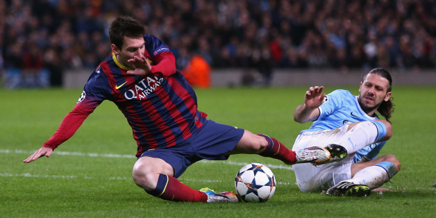 MANCHESTER, ENGLAND - FEBRUARY 18:  Martin Demichelis of Manchester City fouls Lionel Messi of Barcelona to concede a penalty and is subsequently sent off during the UEFA Champions League Round of 16 first leg match between Manchester City and Barcelona at the Etihad Stadium on February 18, 2014 in Manchester, England.  (Photo by Clive Brunskill/Getty Images)