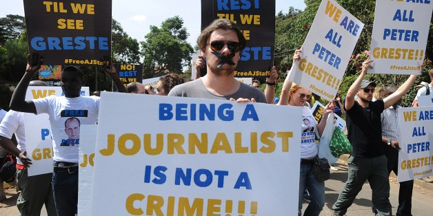 Foreign journalists hold banners as they march to the Egyptian Embassy to show support to Peter Greste, an Australian journalist who was arrested and detained in Cairo while on assignment for Qatar-based Al-Jazeera network, on December 29, 2013, in Nairobi, on February 4, 2014. Greste and two others journalists are accused of spreading lies harmful to state security and joining a terrorist organisation.AFP PHOTO/SIMON MAINA        (Photo credit should read SIMON MAINA/AFP/Getty Images)