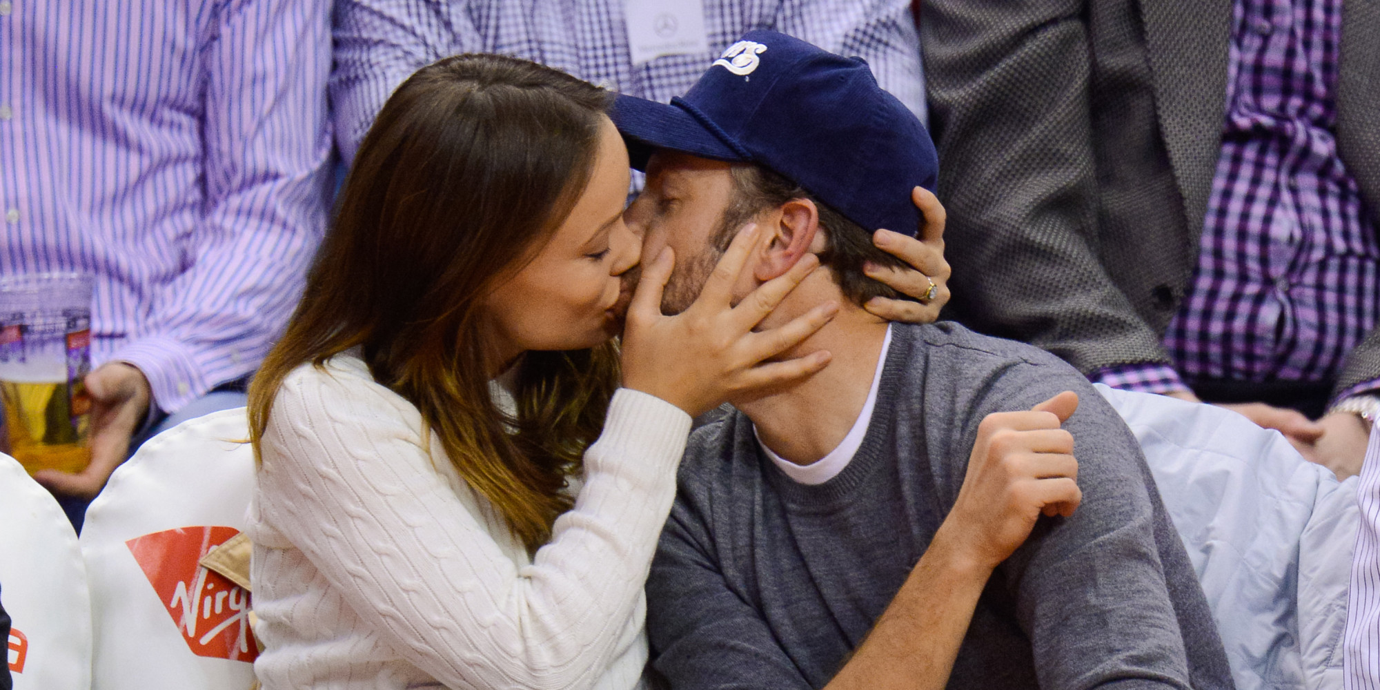 pregnant olivia wilde and jason sudeikis show pda at basketball game