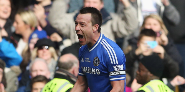 LONDON, ENGLAND - FEBRUARY 22:  John Terry of Chelsea celebrates as Frank Lampard scores their first goal during the Barclays Premier League match between Chelsea and Everton at Stamford Bridge on February 22, 2014 in London, England.  (Photo by Scott Heavey/Getty Images)