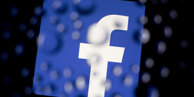 The Facebook Inc. logo is displayed an Apple Inc. iPad Air past water droplets in this arranged photograph in Washington, D.C., U.S., on Monday, Jan. 27, 2014. Facebook Inc. is expected to release earnings data on Jan. 29. Photographer: Andrew Harrer/Bloomberg via Getty Images