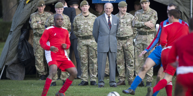 The Duke of Edinburgh (centre) watches a football match during his visit to the First Battalion Grenadier Guards at Lille Barracks in Aldershot, Hampshire.