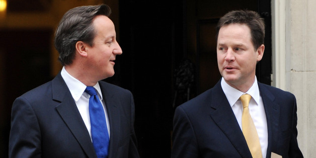 Prime Minister David Cameron (left) and Deputy Prime Minister Nick Clegg, leave 10 Downing Street, London, following a cabinet meeting, as they head off for a visit to Essex.