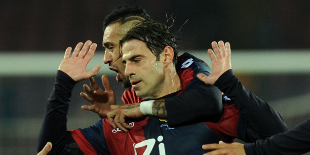 NAPLES, ITALY - FEBRUARY 24:  Emanuele Calaio of Genoa celebrates after scoring the goal 1-1 during the Serie A match between SSC Napoli and Genoa CFC at Stadio San Paolo on February 24, 2014 in Naples, Italy.  (Photo by Giuseppe Bellini/Getty Images)