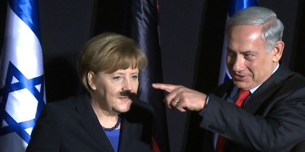 In this video-grab, German Chancellor Angela Merkel (L) and Israeli Prime Minister Benjamin Netanyahu gesture during a joint press conference after their cabinets held a meeting at the King David hotel in Jerusalem on February 25, 2014. Merkel arrived in Israel with her cabinet yesterday to discuss nuclear talks with Iran and to encourage Prime Minister Netanyahu to reach a two-state solution with the Palestinians. AFP PHOTO / YOAV LEMMER        (Photo credit should read YOAV LEMMER/AFP/Getty Images)