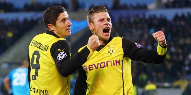 Lewandowski celebrates his first goal with Łukasz Piszczek