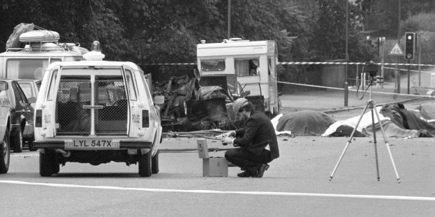 "File photo dated 20/07/82 of a police photographer at the scene of the car bomb, in which four soldiers died, in Hyde Park, London, as the prosecution of the Hyde Park bombing suspect John Downey has collapsed after a ""reckless"" error led to him being given a false assurance that he was not wanted by British police over the IRA attack, it can now be reported."