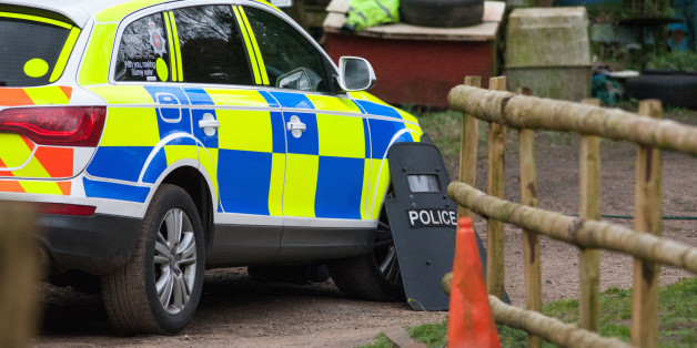 Police at the scene at Keepers Cottage Stud in Waverley Lane, Farnham, Surrey, where two women and four dogs were found shot dead yesterday morning after gunshots were heard, as a 82-year-old man is being questioned over the killings.