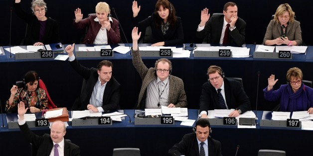 Members of the European Union parliament take part in a vote during a plenary session at the European Parliament in Strasbourg, eastern France, on February 26, 2014. AFP PHOTO / FREDERICK FLORIN        (Photo credit should read FREDERICK FLORIN/AFP/Getty Images)