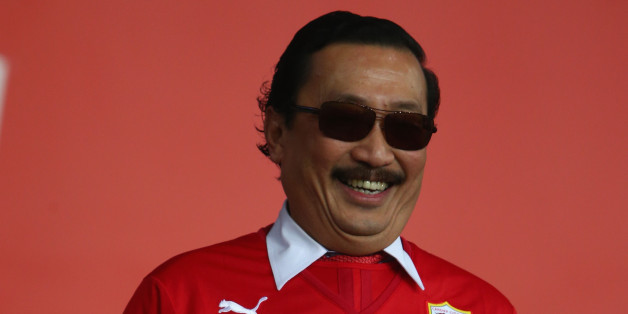 CARDIFF, WALES - DECEMBER28: Sri Vincent Tan the owner of Cardiff City looks on from the directors box ahead of the Barclays Premier League match between Cardiff City and Sunderland at the Cardiff City Stadium on December 28, 2013 in Cardiff, Wales.  (Photo by Michael Steele/Getty Images)