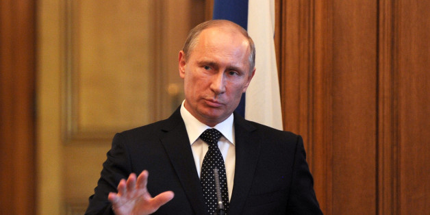 Russian President Vladimir Putin speaks during a press conference inside 10 Downing Street, London.