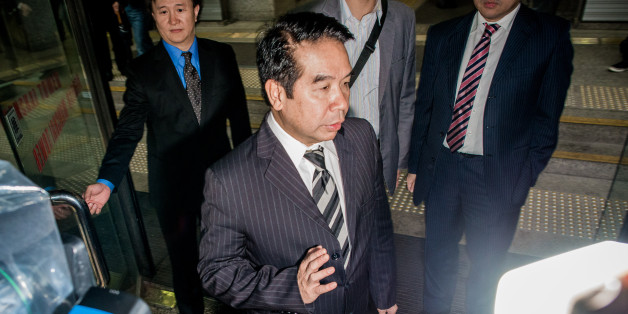 Birmingham City football club owner Carson Yeung walks out of the district court in Hong Kong on November 28, 2012. Former hairdresser-turned-football tycoon Carson Yeung went on trial in Hong Kong on November 28 on money-laundering charges involving tens of millions of dollars, with his lawyers pleading his innocence.  AFP PHOTO / Philippe Lopez        (Photo credit should read PHILIPPE LOPEZ/AFP/Getty Images)