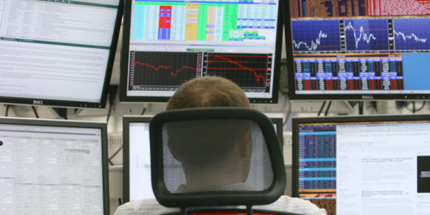 A Russian trader studies markets at a private international investment banking firm in Moscow on October 9, 2008. Russia's main stock markets rebounded more than 12 percent, recouping sharp losses suffered the day before as regulators moved to curb volatility by periodically halting trade.The dollar-denominated RTS exchange was up 12.34 percent at 855.61 points when the Federal Service for Financial Markets froze trading at 1005 GMT, the bourse's web site said. The ruble-based MICEX was up 12.53