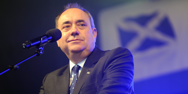 First Minister Alex Salmond making a speech during a march and rally in Edinburgh, calling for a Yes vote in next year's independence referendum. PRESS ASSOCIATION Photo. Picture date: Saturday September 21, 2013. The event appeared to draw crowds from across the country, with marchers filling the top half of the Royal Mile before wending their way along a city centre route. During the day, the gathered crowds were expected to hear speeches from key figures in the pro-independence movement such as First Minister Alex Salmond and his deputy Nicola Sturgeon. The campaigners gathered in the city's High Street before heading slowly along North Bridge, Waterloo Place and Regent Road towards the final destination of Calton Hill. A range of groups took part in the protest, from political parties to organisations such as Farming for YES and Football Supporters for Independence. See PA story POLITICS Scotland. Photo credit should read: Lesley Martin/PA Wire