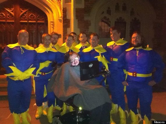 stephen hawking on a stag do with 11 banana men