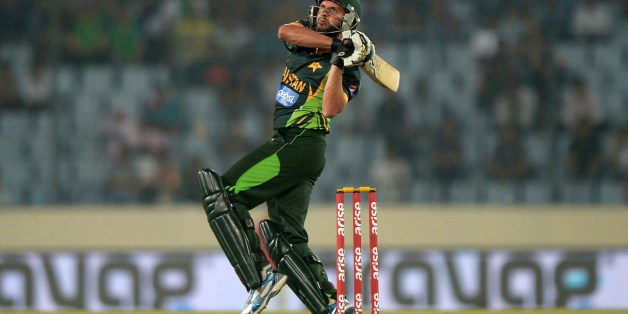 Pakistani batsman Shahid Afridi plays a shot during the eighth match of the Asia Cup one-day cricket tournament between Bangladesh and Pakistan at the Sher-e-Bangla National Cricket Stadium in Dhaka on March 4, 2014. AFP PHOTO/Dibyangshu SARKAR        (Photo credit should read DIBYANGSHU SARKAR/AFP/Getty Images)