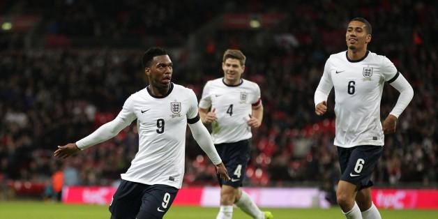 England's Daniel Sturridge (left) celebrates scoring his side's first goal of the game